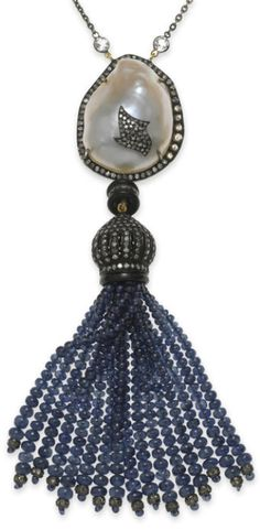 A baroque freshwater cultured pearl, sapphire, diamond and black onyx tassel with white topaz pendant/necklace;