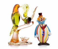 """Selkirk Auctioneers  TWO MURANO GLASS PIECES.  Italy, 20th century. Two birds on a branch, 11.5""""h. Together with a colorful clown, 9""""h.  Estimate $ 100-150"""