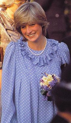 April 20, 1982: Princess Diana visits St Mary's, Scilly Isles. Looks so blooming, so lovely, in pregnancy. Here on a walkabout.. Wearing a pale blue with white polka dots maternity dress, and pearls.