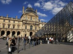 Paris, France  Long queues regularly form outside of the I.M. Pei–designed pyramid at the main entrance of the Louvre. It