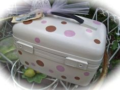 I can finally redo the adorable little purple suitcase I've been holding onto!