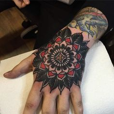 Black and red mandala on the hand Black and red traditional style floral mandal. - Black and red mandala on the hand Black and red traditional style floral mandala tattoo on the lef - Red Tattoos, Life Tattoos, Body Art Tattoos, Sleeve Tattoos, Small Tattoos, Mandala Hand Tattoos, Floral Mandala Tattoo, Flower Tattoo Hand, Old School Tattoo Designs