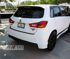 I'm liking this Mitsubishi Outlander Sport - customized by Road Race Motorsports.