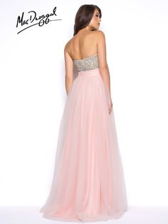 Empire waist pink prom dress with embellished top. Style 20059M features a strapless beaded bodice with gathered tulle overskirt.