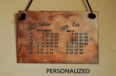 CUSTOM copper plaque,handwriting,personalized rustic wall plaque,gifts,hanging wall plaque,corporate anniversary gift,unique,anniversary. VINTAGE RUSTIC CUSTOM COPPER PLAQUE WITH YOUR BIRTHDATES & NAMES- HANDMADE This copper plaque contains a personalized calendary with your birthdates marked. The example in the ad is actually for november the 12th 1972 & april the 8th 1975. MInd this is the ACTUAL calendar for that year. The plaque can also contain your names or a sentence, even your...
