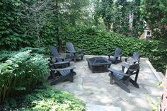 Staging is all about suggestion. this makes it pretty easy to imagine sitting outside with a nice evening fire. Bookcases, Staging, Fire, Patio, Easy, Outdoor Decor, Pretty, Top, Home Decor