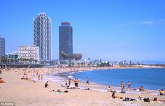 Viva Espana: Blue skies over the beach in Barcelona, Spain - one of two Spanish cities to make the list