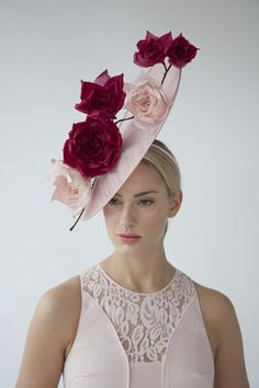 SCULPTED ROSES HAT £450.00  Handcrafted in our London studio.  Sinamay hat with silk dupion handmade flowers.  Colours: Pale Pink, Cerese.  Secured with a comb and hairband.  Sent free within the UK. Includes a Black & White hatbox.  UK delivery 3 weeks.