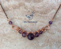 handmade necklace is copper wire wrapped amethyst beads of various sizes in a beautiful criss cross pattern.This handmade necklace is copper wire wrapped amethyst beads of various sizes in a beautiful criss cross pattern. Wire Necklace, Wire Wrapped Necklace, Amethyst Necklace, Wire Wrapped Pendant, Wire Pendant, Copper Necklace, Necklace Sizes, Cross Pendant, Silver Earrings