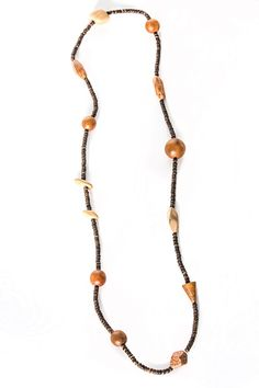 This is a unique, earthy necklace that is made of wooden beads that are dyed in colors that truly complement an earthy boho outfit. Best worn to complement a neutral colored camisole or long strapless dress, or worn amazingly with your skinny jeans and simple black tank. Gives any outfit a simple eclectic touch.   Bohemian Necklace by Creative Treasures. Accessories - Jewelry - Necklaces Beverly Hills, Los Angeles, California