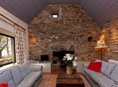 Clifden Seaside Cottage Traditional Sitting Room with High Ceilings & Original Stone Wall & Hearth