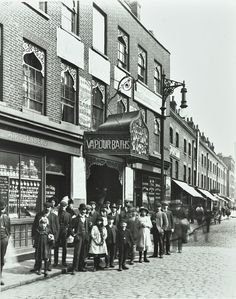 Crowd outside the Russian Vapour Baths Brick Lane, Stepney, London 1904 People stand in the street by the entrance to the baths the porch and windows...