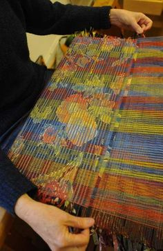 weaves strips of fabric through the multi-colored warp threads on her loom to soften the fabric's original pattern. She'll sew the fabric into curtain panels. - See more at: http://www.wvgazette.com/Life/201306110037#sthash.eLlb5MMW.dpuf