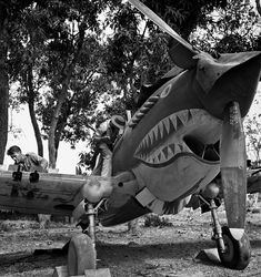 Repairs being carried out on a Curtiss P-40 fighter by a Flying Tigers ground crew in Burma, by George Rodger (1942)