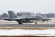 McDonnell Douglas F-18C Hornet: Finnish Air Force HN-433 (cn 1439/FNC033) Taxiing to the military apron after landing on runway 15.