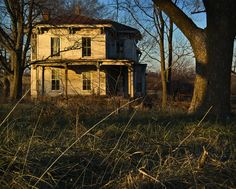 """Palmyra, Missouri -- Photographer said """"found this house north of Palmyra, Missouri in Marion County. A couple of quick shots since people were driving by on the gravel road and there was purple paint on posts. Not sure how far spread the Purple Paint law is, but here it means that it is worse than No Trespassing."""""""