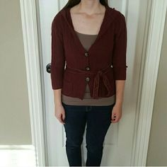 Aeropostale hooded sweater! Cute maroon hooded v neck sweater! Has 3 brown/cream buttons and ties at the waist. In great condition! Aeropostale Sweaters