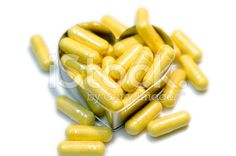 Yellw capsules drug in  heart royalty-free stock photo