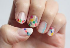 The tutorial for this is incredibly convoluted for something that looks so whimsical and random, but I still love it.  {Nail Art: Triangle + Square Nails via Small-Good-Things.com}