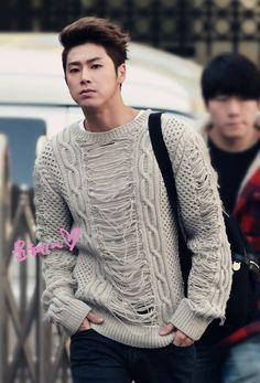 "This would be a bad example of an outfit. There are far too many lines in his sweater that are clashing which don't really emphasize anything. A rectangle form is shown here as there is no real difference in his waist, shoulders, and hips. The texture is a visual and tactile texture as you can nearly feel and see the middle and sides of his shirt that are ""ripped"". The clothing does not help his winter skin color because of that beige color."