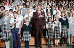 President Ronald Reagan saying the pledge of Allegiance during a visit to St. Agatha's Catholic High School in Detroit, Michigan. 10/10/84.