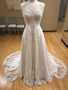 Perfect for brides with a classic wedding-day style in mind, this cap sleeve wedding dress from Essense of Australia is a romantic dream! (Style: D1919) #MichellesBridal #Wedding #Dress #Gown