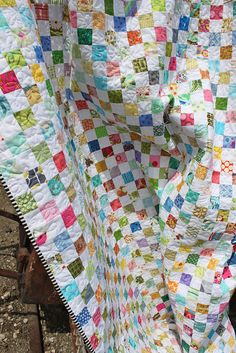 THIS one inspires me to try a postage stamp quilt.