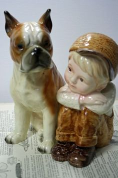 In Ouma Babs's display cabinet were figurines such as this... I remember a spaniel-type doggie that my sister, cousin and I fought about the most.