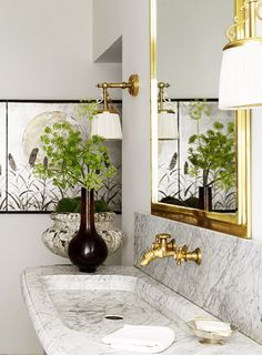 Marble and brass bathroom in a glamorous Paris apartment via @thouswellblog