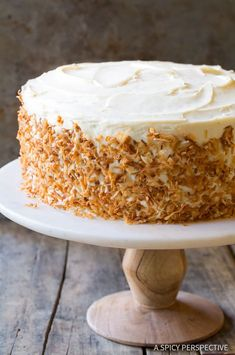 The Best Carrot Cake Recipe - A moist and tender carrot cake with tangy cream cheese frosting. Easy to make and assemble, and always a hit at any gathering!