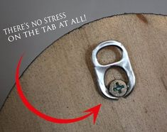 Yet another use for drink can ringpulls!  Use to create a hanging loop for picture frames by screwing into the back.