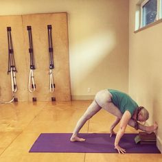 A premium #parsvottanasana #intensesidestretch with two blocks under the front foot for extra leg stretch- make space in the concave stage first! #DevonDederich #forwardfold #yoga #forwardbend #yogini #yoginilife #iyengaryoga #yogaforeveryone #yogaforflexibility #yogaforhealth