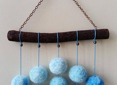 Amazing pompon wall hanging with handmade acrylic pompons hanging by a cotton cord. Length 20,08 (51 cm). Width of wooden stick (oak) 8.27 (21 cm). Diameter of pompons 1.57 (4cm).