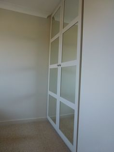 Fitted wardrobes with mirrored panels