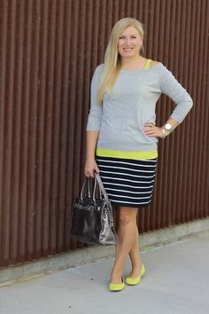 love everything about this. sweater over a dress so it resembles a pencil skirt, and with flats
