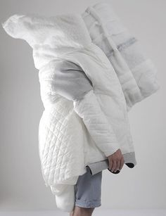 Sewn as a Site wearable bed covers designed by Danica Pistekova to be a cross between clothing and a house.