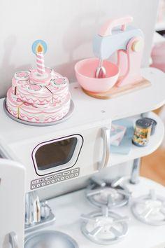 Kidkraft vintage kitchen, pastel mixer, melissa & doug cake, wooden toys - click  thru to read how I designed my girls shared bedroom. Ikea | Kallax | Book Shelf | Toy Storage | Play Room | Reading Nook | Fiddle Leaf | Hemnes nightstand | Hemnes bed | Bedroom | Toddler |  Home Decor | Home Design | Hemnes Twin Bed | Single Beds | Girls room | Girls Bedroom | White Bedroom | White furniture | Minimal | Minimalist Design | Pink | Blush | Rustic | Shabby chic | Simple | Neutral | Modern |