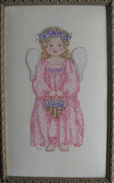 "Cross stitch on light yellow 14 count Aida.  ""Spring - The Earth Angels"" by Alma Lynne's Works of Heart."