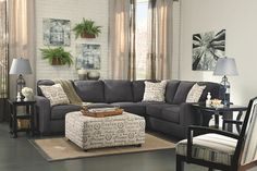 This living room features charcoal black love seat, armless chair, sofa, and accent chair
