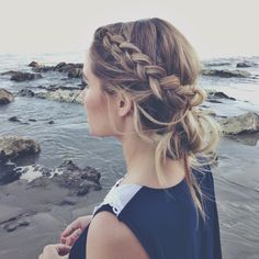 A lovely thick braid pulled back into a messy bun<3