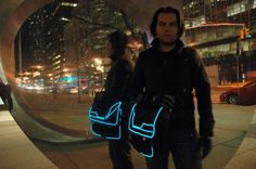 Add cool spacey EL light wire to a messenger bag. This guy is ROCKIN' the man bag Tron style! Good work, my friend. Here's our EL wire to re-create the look - simply sew it: http://www.flashingblinkylights.com/new-el-wire-light-neon-blue-sku-no-11537-bl.html?utm_source=Pinterest&utm_medium=EL%20Wire&utm_campaign=DIY%20Light%20Craft