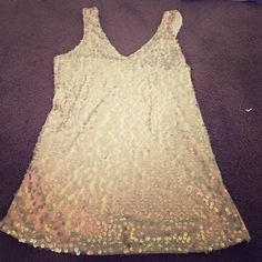 Charlotte Russe top This top is so stunning with its gold sequins! Amazing condition and less than half the original price!! Charlotte Russe Tops Tank Tops