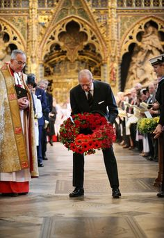 Reverend Dr John Hall Dean of Westminster looks on as prince phillip lays a wreath after the dedication of a new memorial stone to admiral Phillip Arthur . News Photo 451904884