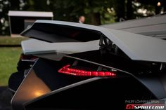 Very thin taillights on the Lamborghini Egoista, also note there are two rear wings on this car, one at either side ... here they are in the...