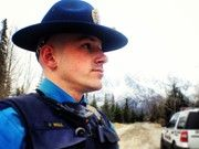 Alaska State Troopers--Trooper Noll stands in wait during his patrol on a rural sidestreet in the Mat-Su Valley.