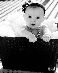 uh oh! 6 month photo session. Baby in a basket