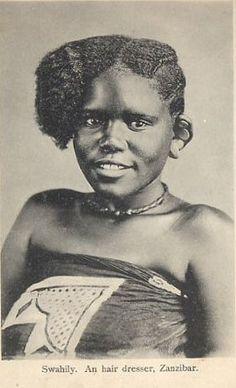 Getting her hair did. Young Swahili girl from Zanzibar