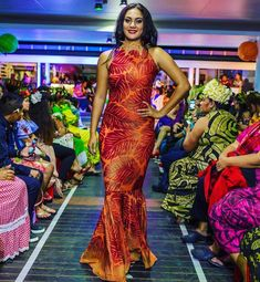 The Color Orange draws optimism and rejuvenates your spirit combined with Red prints which stimulates energy so why not wear it in your… Different Dresses, Types Of Dresses, Ethnic Fashion, African Fashion, Polynesian Dresses, Hawaiian Dresses, Samoan Dress, Hawaiian Fashion, Formal Dress Patterns