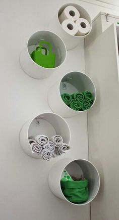 Sono tubes with L brackets to mount would make great storage. Cute too!