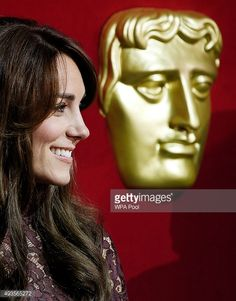 Catherine, Duchess of Cambridge, reacts as she attends a BAFTA presentation with Chinese President Xi Jinping at Lancaster House on October 21, 2015 in London, England.